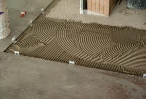 Preparing a floor to lay tiles